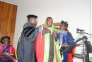 A PhD graduand Issaka yakubu being robed.jpg