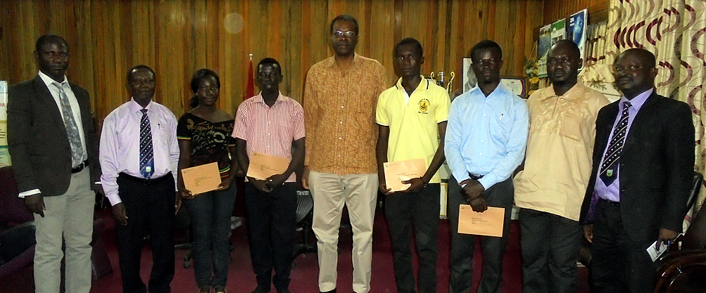 The Beneficiary Students in a group photograph with the Vice Chancellor Prof J.S.Y. Kuma and other Officials