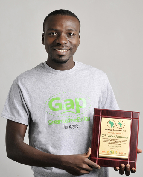 Mr Kwame Ababio with His Award