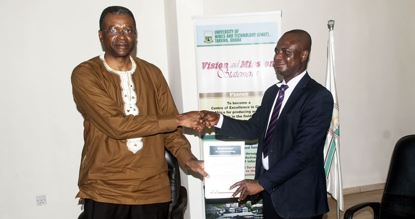 Prof Kuma Exchanging the the Signed Documents with Prof Asiamah Yeboah