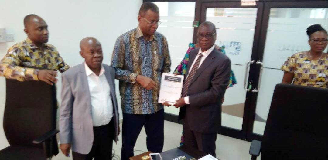 Dr K. K. Sarpong and Prof Kuma Exchanging the Signed MoU