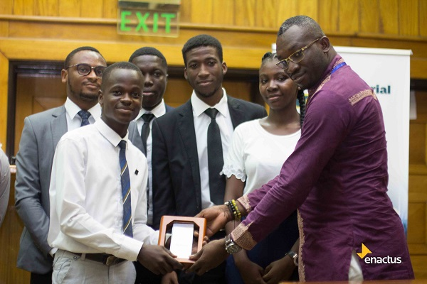 Mr Joseph Adu Gyamfi Left Receiving the Award on Behalf of the Enactus UMaT Team