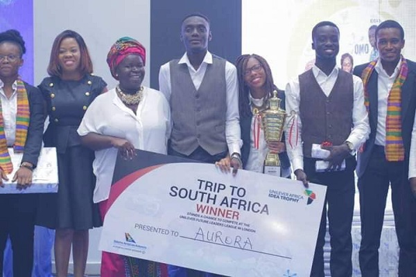 Team Aurura Receiving their Ticket for the Trip To South Africa