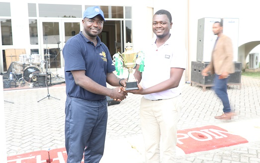 Dr Eric Wia UTAG Rep Receiving the Overall Trophy from Prof Bernard Kumi BoatengDean of Students
