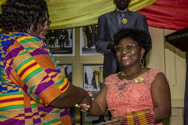 Prof Grace Ofori Sarpong Being Congratulated by the President of the Academy Prof Mrs Henrietta Mensah Bonsu